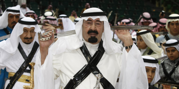 King Abdullah of Saudi Arabia, center, holds his sword as he takes part in the traditional Arda dance, or War dance, during the Janadriyah Festival of Heritage and Culture on the outskirts of Riyadh, Saudi Arabia, Tuesday, March 10, 2009. (AP Photo/Hassan Ammar)